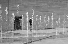 April Showers (cathbooton) Tags: city people reflection building water wall liverpool canon 50mm outdoor april fountains showers brickwork