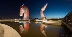 Kelpies Reflected (buddsnax) Tags: uk sunset sculpture reflection reflections stars scotland pano panoramic publicart falkirk m9 andyscott thehelix kelpies kelpieturningpool
