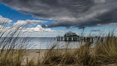 Cloudy day (hjuengst) Tags: beach reed clouds strand pier weed wolken balticsea gras timmendorf ostsee teahouse schilf steg