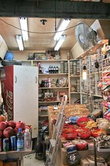 Jerusalem - Market (David K. Marti) Tags: street city blue light shadow red urban white color colour fruits yellow israel store fridge wire colorful cityscape market interior room jerusalem indoor cable goods east shelf business indoors spices colored inside merchandise ladder middle ventilator