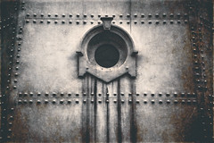 Rivets and Rust: A Dark Tower (ScottNorrisPhoto) Tags: lighthouse tower metal architecture dark photography scary rust rivets moody details structure explore porthole worn weathered ornate textured muted steampunk roundwindow steelplates 365project scottnorrisphotography