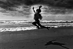 my youngest daughter exercising on the beach - Tel-Aviv (Lior. L) Tags: travel sea beach monochrome silhouette freedom blackwhite jumping exercising