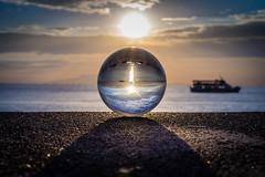 The boat and the sunset (Hendraxu) Tags: travel sunset sky sun water sunshine ball photography boat seaside crystal creative seashore