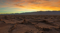 Badlands (David Colombo Photography) Tags: blue sunset orange brown mountains yellow landscape nationalpark nikon rocks desert outdoor patterns salt deathvalley badlands range d800 mountainrange davidcolombo davidcolombophotography