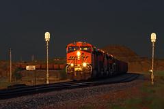 Sunset at Sully Springs (Moffat Road) Tags: sunset storm lowlight signals northdakota nd locomotive ge bnsf darksky stormlight coaltrain sullysprings