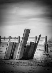 HAPPISBURGH SEA DEFENCE - JANUARY 2016 (mrstaff) Tags: lighthouse art beach danger rocks surf waves bright debris norfolk dry windy sunny cliffs groyne happisburgh coastalerosion seadefense martinstafford january282016