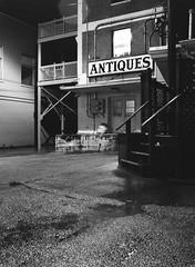 After Hours (TnOlyShooter) Tags: film night analog alley tennessee columbia rainy antiques maury ilforddelta3200 mamiya6451000s mamiyasekorc55mmf28 filmboxlab