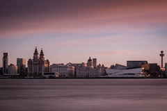 sunrise over Liverpool waterfront from Birkenhead (dean hepworth) Tags: city longexposure water liverpool sunrise river fuji waterfront threegraces fijifilm merseyside liverbuildings xe2 xf1855