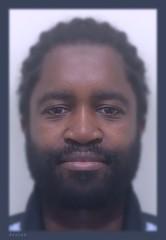 Portrait of JP / Mirrored Image (swampzoid) Tags: man blur male face dark beard nose eyes focus image african ears front lips barber mirrored blackman hairstyle bearded darkeyes facialfeatures darkface