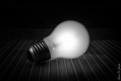 Project 366 - 32/366 : Endless light (sdejongh) Tags: wood light shadow blackandwhite texture monochrome closeup bulb contrast screw globe atmosphere stillife lowkey incandescent