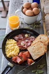 Country breakfast (Thainlin Tay) Tags: morning orange breakfast bacon juice toast tomatoes eggs scramble