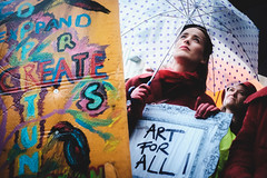 (Nervous Pete) Tags: street portrait wales lady umbrella 35mm march crowd cymru protest arts cardiff rainy caerdydd marching raining xe2 f14r cardiffwithoutculture