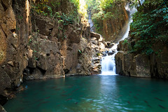 Waterfall of Phlio National Park (jack-sooksan) Tags: park travel cliff brown mountain fish black tree green nature wet water pool beautiful rain rock stone forest swim river dark relax thailand flow waterfall leaf cool pond soft smooth drop fresh national jungle level emerald chanthaburi