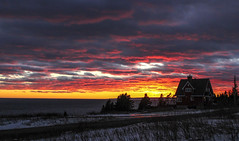 Atlantic Winter Sunset (vamp8888) Tags: ocean christmas winter sunset sky house snow canada tree ice nature silhouette clouds canon landscape photography eos photo december sigma noel atlantic 7d 30mm14 burningsky gaspesie sigma30mm14 canoneos7d