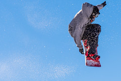 Flying Trick (Zimeoni) Tags: blue winter sky snow flying jump spain nevada andalucia sierra granada trick snowboarder burton arnette boll