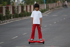Little Dude in Red (Rahul Gaywala) Tags: street family boy people dog pet game art girl childhood cat painting fun bicycling cycling sketch chalk drawing walk board crowd innocent social gathering uturn hover surat sketing
