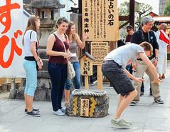 Love Stone (Carl_W) Tags: travel people love japan stone canon temple eos kyoto fortune kiyomizudera lovestone kyotocity purewatertemple 550d canoneos550d eos550d lovefortunetellingstone 550dcanon