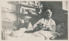 Elderly woman with her dog in bed (simpleinsomnia) Tags: old woman pet white black monochrome animal vintage found blackwhite bed antique interior snapshot photograph elderly vernacular oldwoman foundphotograph