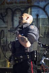 Kensington Cop (Anne J Gibson) Tags: outdoors streetphotography tattoos cop kensingtonmarket torontopolice