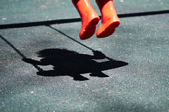 Little Red Riding Boots (adzman_808) Tags: shadow outdoors fuji play availablelight naturallight swing porto fujifilm playtime zz fujixpro1 fujifilmxpro1 xf60 portolight