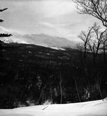 Weather change (threepinner) Tags: ski japan spring hokkaido skiing cloudy daytime biei tmax100 hokkaidou  selfdeveloped 75mm   northernjapan   f34 mttokachidake  ebcfujinon mountainsnaps mtmaruyama finedol taisetsunationalpark fujiholga120s