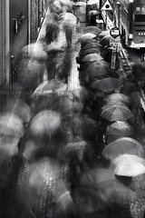 Umbrellas in Motion (Wilson Au | ) Tags: street longexposure blackandwhite motion monochrome rain canon hongkong mood rainyday multipleexposure rainy slowshutter umbrellas kwuntong powershotg7x