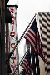 America in a picture (Milou Diable) Tags: newyorkcity newyork building sign buildings manhattan flag americanflag icon signage redwhiteandblue radiocity iconography symbolism