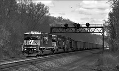 593 (Images by A.J.) Tags: railroad bw white black train pittsburgh pennsylvania ns norfolk line southern pa greensburg coal signal hopper freight prr conrail emd sd60i