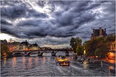 Ominous clouds over the Seine (alcowp) Tags: sky storm paris france tourism seine night clouds river boat louvre transport eiffeltower bateau orsay fra