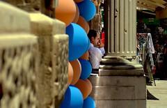 Maltese Cigarette Break (sidewinder_7777) Tags: street portrait architecture balloons break dof cigarette malta smoking thinking pensive column coppola godfather valletta