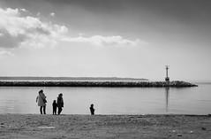 By the sea.. (Thanosss) Tags: family winter boy sea blackandwhite lighthouse beach monochrome clouds canon seaside greece 7d thessaloniki timeless macedonian makedonia kalamaria  macedoniagreece