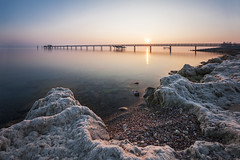 At lake constance (pixadeleon) Tags: lake reflection water sunrise stones jetty bank bodensee longexopsure altnau challengegamewinner