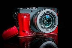 Leica D-Lux Type 109 (Heath Cajandig) Tags: camera leica red leather lens photography grey gray case panasonic luxury 109 dlux lx100 removedfromstrobistpool incompletestrobistinfo seerule2