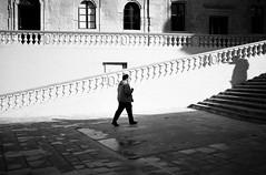 man vs. shadowman (gato-gato-gato) Tags: street leica bw sun white black classic film blanco monochrome analog person holidays europa europe flickr noir mt strasse urlaub negro streetphotography eu pedestrian rangefinder malta insel human streetphoto manual monochrom sonne weiss blanc ferien m6 manualfocus schwarz februar wetzlar onthestreets gozo passant mensch leicam6 mediterranian streetphotographer mittelmeer sden fussgnger manualmode strase filmisnotdead streetpic messsucher manuellerfokus gatogatogato fusgnger leicasummiluxm35mmf14 irrabatgawdex gatogatogatoch wwwgatogatogatoch streettogs believeinfilm