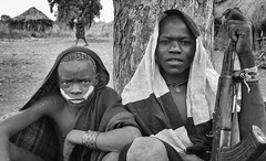 Mursi Tribe, Ethiopia (Rod Waddington) Tags: africa two people blackandwhite male monochrome face gun village outdoor african painted traditional culture valle tribal afrika omovalley ethiopia tribe ethnic mago mursi cultural afrique ethiopian omo etiopia ethiopie