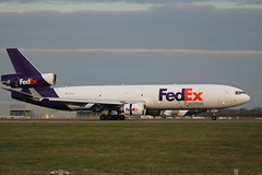 N607FE MD-11F Stansted. (David Cook.) Tags: cargo boeing fedex stansted md11 mcdonnelldouglas trijet federalexpress cargoaircaft