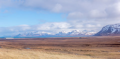 Vast Vista around Rif (Glen Sumner Photography) Tags: blue panorama sun mountain snow mountains nature landscape landscapes iceland airport ngc vista grasslands rif vast