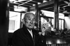 Time's indelible stamp~ Qibao (~mimo~) Tags: china old portrait man asia shanghai time smoke streetphotography age cigarettes teahouse nicotine qibao mimokhairphotography qibqo