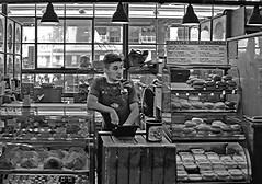Bagel Seller (sea turtle) Tags: seattle city urban blackandwhite bw shop blackwhite store downtown market bagel shops pikeplacemarket stores pikemarket seattlebagelbakery