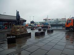 Dr John Rae and Stromness Harbour (Dunnock_D) Tags: uk sky cloud statue boats grey scotland orkney cloudy unitedkingdom harbour explorer arctic rainy stromness paved johnrae drjohnrae