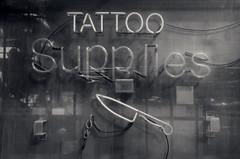 Tattoo Supplies (Revisited) (JeffStewartPhotos) Tags: blackandwhite bw toronto ontario canada sign blackwhite store neon letters storefront signage toned queenstreet leslieville queenstreeteast studioone walkingwithdavidw walkingwithsashaf walkingwithmaryc studioonetattoosupplies