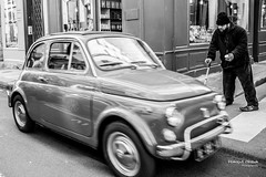 Stop that car (Franois Escriva) Tags: street city light people bw white man black paris france car photo noir fiat candid streetphotography mini nb beggar 500 rue blanc begging