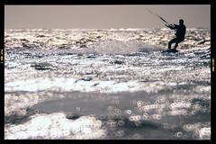 (DhkZ) Tags: ocean sunset sea waves bokeh kitesurfing canon10d caribbean bahamas nassau donutbokeh rubinar300mmf45mirror