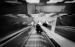 Abwrts II (AxelN) Tags: longexposure blackandwhite bw germany munich mnchen bayern deutschland bavaria escalator sw rolltreppe langebelichtung schwarzweis langebelichtungszeit