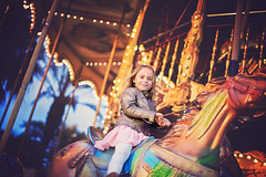 Holidays !!! (danrunisland) Tags: horse girl children happy holidays child carousel