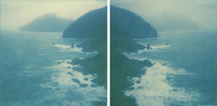 on heels of Nautilus (www.matteovarsi.com) Tags: sea sky cliff island rocks waves foam seashore impossible colorfilmxsx70camera