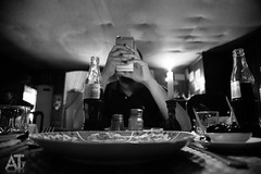 Smartphone Slave (ATphotographs) Tags: monochrome dinner canon distraction 6d