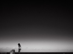 Soldiers Beach Lookout (Daniel Arnaldi) Tags: ocean sky blackandwhite water girl landscape wind windy australia newsouthwales centralcoast australasia longhaired oceania darkhaired landscapephotography blackandwhiteimage soldiersbeach danielarnaldiphotographer