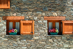 Two windows in Catalunya (clodio61) Tags: old urban house mountain plant flower color building window stone architecture photography spain europe day exterior village outdoor traditional pot catalunya typical pyrenees potted laparroquiadhorto