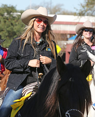 Cowgirl Rides (wyojones) Tags: horse woman cute girl beautiful beauty hat sunglasses necklace pretty texas houston shades parade pillow jacket blonde cowgirl lovely cowboyhat saddle trailride houstonlivestockshowandrodeo cowgirlhat saddlehorn wyojones houstonlivestockandrodeoparade